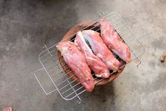 Raw pork steaks cooking on barbecue grill Royalty Free Stock Photography
