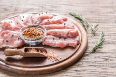 Raw pork steaks on the wooden board Royalty Free Stock Photography