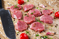 Raw pork tenderloin on crumpled paper. ready to cook. Royalty Free Stock Photo