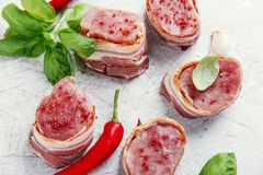 Raw Pork tenderloin medallions with bacon wrapped Royalty Free Stock Photo