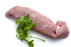 Raw pork tenderloin. And parsley on white background Stock Image