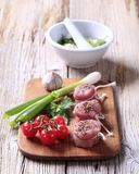 Raw pork tenderloin and vegetables Stock Images