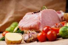 Raw pork and vegetables. On a canvas background Royalty Free Stock Images