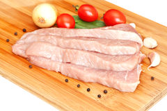 Raw pork with vegetables Stock Images