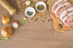 Raw pork, vegetables and spices. Raw pork and vegetables on beckground. Slate background. copy space Royalty Free Stock Photography
