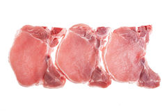 Raw pork on a white background. Copy space Stock Image