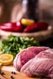 Raw pork on a wooden board royalty free stock photos