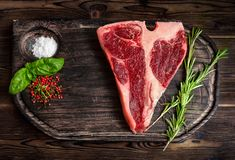 Fresh porterhouse beef steak with herbs