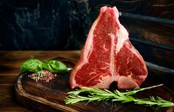 Raw porterhouse steak with rosemary