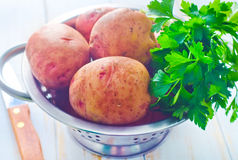 Raw potato. And fresh parsley Stock Photography