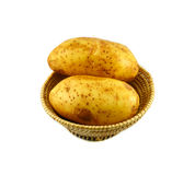 Raw Potato in basket Stock Images