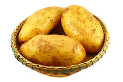 Raw Potato in basket Royalty Free Stock Image
