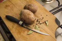 Raw potato with black pepper and bay Royalty Free Stock Images