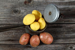 Raw potato on board. Important industrial vegetables. Basic food Stock Photography