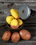 Raw potato on board. Important industrial vegetables. Basic food Royalty Free Stock Images