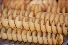 Raw potato chips. On the stick ready for preparation Stock Photos