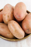 Raw potato in dish Royalty Free Stock Photography