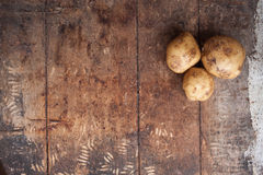 Raw potato food . Fresh potatoes on wooden background. Free plac. E for text. Top view Stock Photo