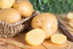 Raw potato food. Fresh potatoes on wooden basket. Raw potato food. Fresh potatoes on wooden basket Royalty Free Stock Image