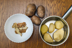 Raw potato food . Potatoes on a wooden table . Free space for te. Xt. Top view Royalty Free Stock Photography