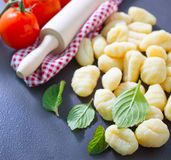Raw potato gnocchi. On the wooden table Stock Image