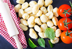 Raw potato gnocchi. On the wooden table Royalty Free Stock Photography