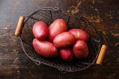 Raw potato in metal basket Royalty Free Stock Photography