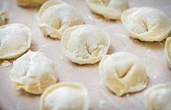 Raw potato pelmeni. (ravioli) before boiling - traditional Ukrainian (Russian) food Royalty Free Stock Images