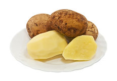 Raw potato on the plate isolated Royalty Free Stock Photos