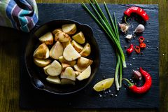 Raw potato slices with herbs, spices Royalty Free Stock Images