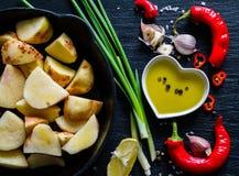 Raw potato slices with herbs, spices Stock Photo