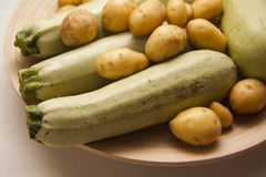 Raw potato and squash Stock Photos