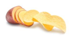 Raw potato and tasty chips royalty free stock photos