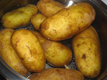 Raw potatoes. In water waiting to be cooked Royalty Free Stock Photography