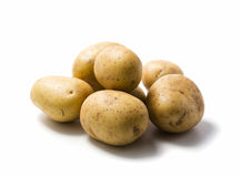 Raw potatoes. Some raw potatoes isolated on white Royalty Free Stock Photography