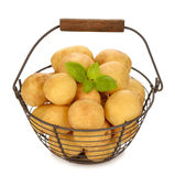 Raw potatoes in a basket Stock Photos