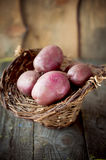 Raw potatoes in a basket Royalty Free Stock Photography