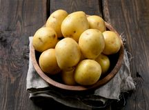 Raw potatoes in bowl Royalty Free Stock Images