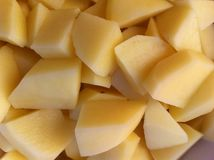 Raw potatoes in the bowl. Raw potatoes ready to cook Stock Image