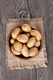 Raw potatoes in bowl Stock Images