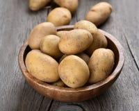 Raw potatoes in bowl Stock Image