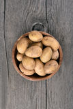 Raw potatoes in bowl Royalty Free Stock Photography