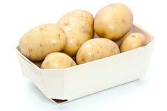 Raw potatoes in carton Stock Image