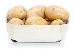 Raw potatoes in carton Stock Images