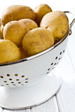 Raw potatoes in colander Royalty Free Stock Image