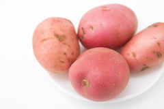 Raw potatoes in dish Royalty Free Stock Photos