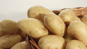 Raw potatoes, food backgrounds stock video footage