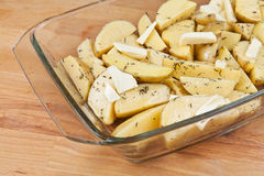 Raw potatoes in a glass tray, ready to be roasted Royalty Free Stock Images