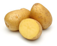 Raw potatoes and half potato stock photos