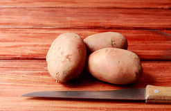 Raw Potatoes and Knife Stock Photos